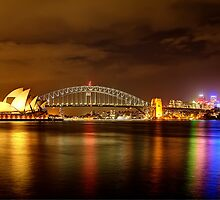 Sydney Opera House and Harbour Bridge glowing at night by renekisselbach