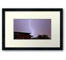 Lightning over houses in Australia Framed Print