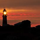 Lighthouse Sunset by fotosic