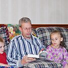 Reading the Christmas story to the grandkiddos by Penny Rinker