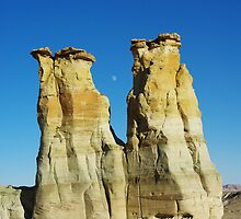 Rock towers and moon in secluded canyon valley, Utah by Claudio Del Luongo