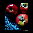Malus Domestica - Red McIntosh Apples In Dark Blue Wicker Basket  by  Sophie Smith