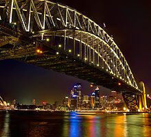 Sydney Opera House and Sydney Harbour Bridge glowing at night by renekisselbach