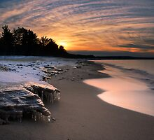 Sunset on frozen Lake Superior shores by DArthurBrown