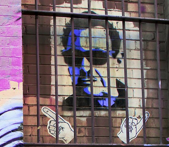 Melbourne Graffiti Street Art - Bono behind bars by NicNik Designs