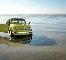 Yellow Fiat Cinquecento on the beach by monsieurI