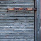 Old barn wall with hinge by Kristian Tuhkanen