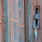 Old barn wall and lock by Kristian Tuhkanen