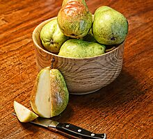 Cut Pear with Pears in Wood Bowl by dbvirago