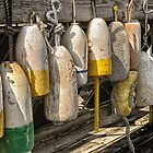 Old buoys dockside by woodnimages