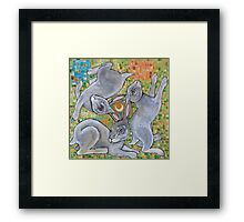 Three Hares Chase the Moon Framed Print