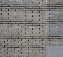 White brick wall by Kristian Tuhkanen