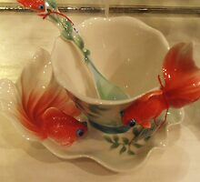 Fish and a teacup by Carol Dumousseau