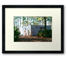 Old-timey service station under the pines Framed Print