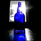 Sun Rays Behind Cobalt Blue Glass Bottle  by © Sophie Smith