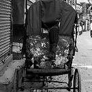 Rickshaw boy at rest by John Callaway