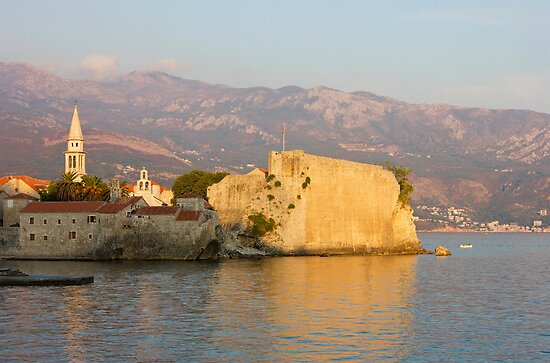 Sunset over old Town Budva in Montenegro by kirilart