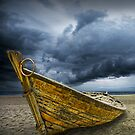 Beached Boat with Storm Brewing by Randall Nyhof