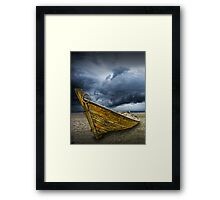Beached Boat with Storm Brewing Framed Print