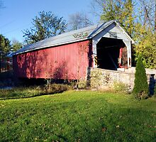 Hassenplug Covered Bridge Under Blue October Skies by Gene Walls