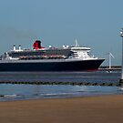 The Queen Mary 2 passing New Brighton Lighthouse on it's way into Liverpool. by Alan Gillam