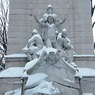 Statue in Snow, Columbus Circle, New York City by lenspiro