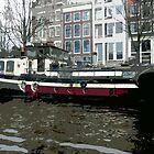 River Boats in Amsterdam by Lorren Stewart