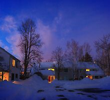 Warmth of home on a snowy eve by Owed to Nature