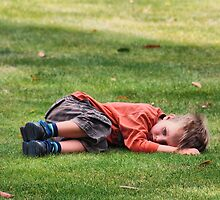 A little sad boy on the grass by andreisky
