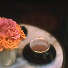 Rose Bouquet in Vase with Cup & Saucer on Table by Tamarra