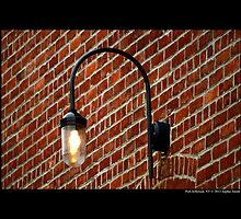 Outside Light Fixture Against Red Brick Wall - Port Jefferson, New York  by © Sophie W. Smith