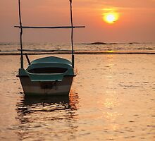 Boat at sunset by naumenko