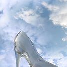 glass high heel shoe on rocky stone surface by morrbyte