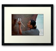 Man painting his Thai taxi boat Framed Print