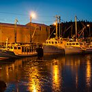 Fishing boats at the wharf by Randy Hill