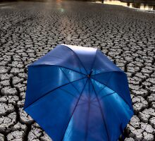 Dried up River Bed and umbrella by pictureguy