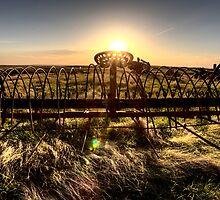 Antique Farm Equipment sunset Saskatchewan Canada by pictureguy