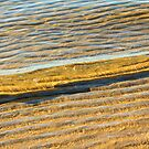 Wave over Sand by Silken Photography