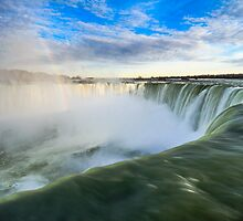 Rainbow Rises from Niagara Falls Waterfall by Peta Thames