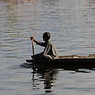 Splashing in the water caused due to Kashmiri man rowing a small wooden boat by ashishagarwal74