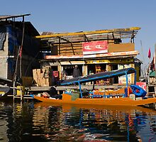 Floating shop (shikara) along with another shop by ashishagarwal74