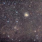 Fireworks Galaxy And The Star Cluster by Sylvain Girard