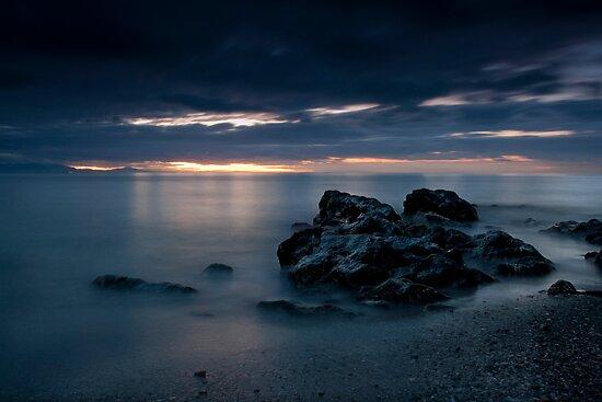Sunrise Over The Rocks by Dave Godden