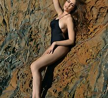 Swimsuit model posing in front of rocks in Palos Verdes, CA by Anton Oparin