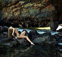 Topless model posing in front of rocks in Palos Verdes, CA by Anton Oparin