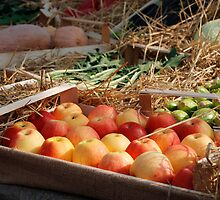 Box of Red Apples in Fruit and Veg Display by jojobob