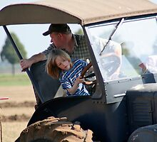 Young Boy and Old Tractor by Stefanie Köppler