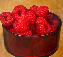 Raspberries in Red Dessert Dish by Jay Gross