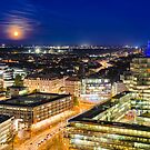 Moon rising over Hannover, Germany by Mapics