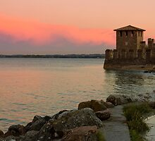 Lake Garda sunset with the tower of The Scaliger Castle by kirilart